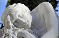 Sculpture woman resting in the cemetery Stock Image