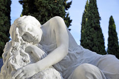 Sculpture woman resting in the cemetery Stock Images