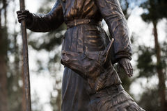 Sculpture of a woman sapper with a service dog shepherd Royalty Free Stock Images