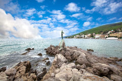 Sculpture of the woman with the sea. Royalty Free Stock Images