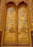 Sculpture wood for  architecture. Sculpture and Carving Temple Doors Thailand handmade story of religious literature on wood and decorated with natural wood Stock Photo