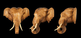 Sculpture (wood) picture elephant head. Isolated on pure black Royalty Free Stock Photo