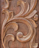 Sculpture wood. Texture part of sculpture wood entrance door Stock Photo