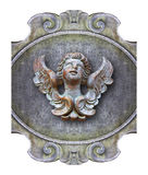 Sculpture of a wooden angel against an old classical plaster  Stock Photo