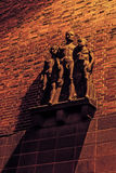 Sculpture of the young boys. By German artist Walter Tuckermann on the facade of the school in Bytom on December 25, 2015. Created in nazi realism style Royalty Free Stock Photo