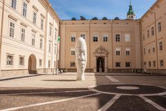 Sculpture of young girl`s head in Dietrichsruh courtyard of University of Salzburg Stock Photo
