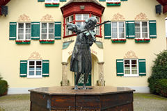 Sculpture of young Mozart playing the violin in front of the Town Hall. Village Sankt Gilgen, Austria. Royalty Free Stock Photo