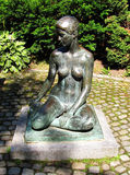 Sculpture of young nude woman Stock Images