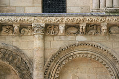 Sculptured animals and fantastic characters decorate the facade of a church (France). Sculptured animals and fantastic characters decorate the facade of Notre royalty free stock image