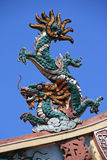 A sculptured dragon decorates the ridgepole of a buddhist temple in Saigon (Vietnam) Royalty Free Stock Image