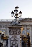 Sculptured gate post with a vintage lamp of Buckingham Palace in London, England, Europe Stock Photos