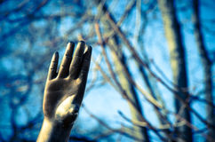 Sculptured hand trying to touch up Royalty Free Stock Photo