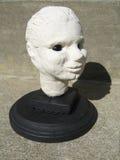 Sculptured head on a pedestal. A sculptured head on a black pedestal stock image