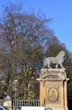 A sculptured lion on a pillar Royalty Free Stock Photography