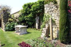 Sculptured marble table & statue at the Italian garden of Hever castle in England Stock Photos