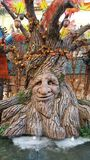 Sculptured Oak Tree with Carved Face Stock Photo