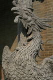 A sculptured phoenix decorates a pillar in the courtyard of a buddhist temple in Hoi An (Vietnam) Royalty Free Stock Photography