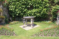 Sculptured table at the Italian garden of Hever castle in England Royalty Free Stock Images