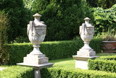 Sculptured vases or urns Stock Photos