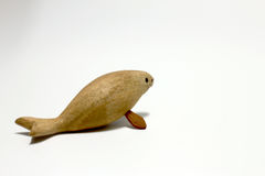 Sculptured wood of the extinct Steller's sea cow isolate on white background. stock photography