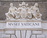Sculptures above an entrance to the Vatican Museum Stock Photo