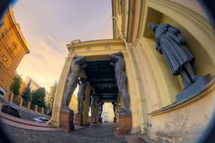 Sculptures of Atlantis of the New Hermitage, Saint Petersburg, Russia. Fish eye lens creating a super wide angle view. Royalty Free Stock Photography