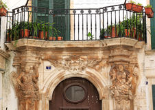 Sculptures and balcony in Martina Franca, Italy Royalty Free Stock Photography
