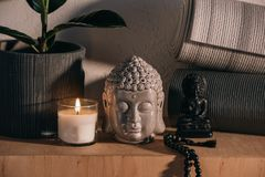 Sculptures of buddha and yoga mats royalty free stock images