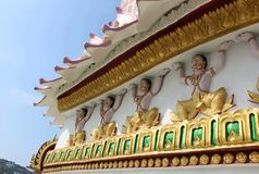 Sculptures of buddhist gods and decorations on the walls of a Buddhist temple royalty free stock photo
