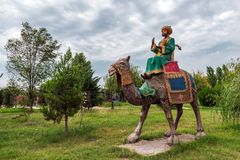 Sculptures in city park, camel rider. Khachmaz, Azerbaijan - September 02. 2018. Sculptures in the city park, camel rider stock photos