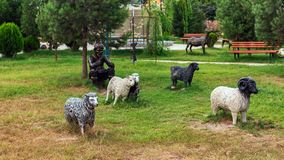 Sculptures in city park, shepherd and sheeps. Khachmaz, Azerbaijan - September 02. 2018. Sculptures in the city park, shepherd and sheeps royalty free stock image