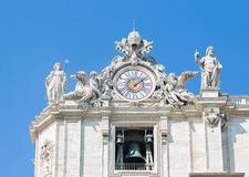 Sculptures and clock on the facade of Vatican city works. Vatican. Rome. Italy. Vatican; European; Clock; bell; time; arrows; History; Italy; Catholicism; Pope Royalty Free Stock Photo