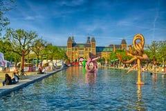 Sculptures dans l'eau près du musée de Rijksmuseum Amsterdam en Hollande Images libres de droits