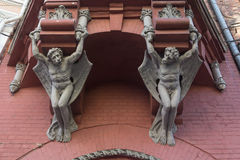 Sculptures demon with wings on wall of house in Kiev Royalty Free Stock Photos