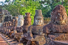 Sculptures of demons of Asia. Photographed in the temple complex of Angkor Wat, Cambodia Royalty Free Stock Photos