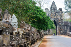 Sculptures of the demons near by the entrance to the temple Bayon Stock Photography