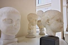 Sculptures depicting child`s heads stock photos