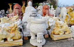 Sculptures en marbre de Bouddha sur le tissu Photo stock