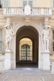Sculptures on a facade of Castiglioni palace in Mantua. MANTUA, ITALY - JULY, 23, 2016: sculptures on a facade of Castiglioni palace in Mantua, Italy Royalty Free Stock Photography