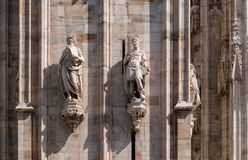 The sculptures on the facade of the Duomo. Milan, Italy. Royalty Free Stock Images