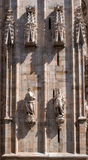 The sculptures on the facade of the Duomo. Milan, Italy. Royalty Free Stock Photo