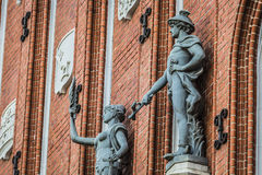 Sculptures on the facade of the House of Blackheads in Riga, Lat Stock Photos