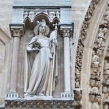 Sculptures on facade of Notre Dame (catholic cathedral) in Paris Royalty Free Stock Image