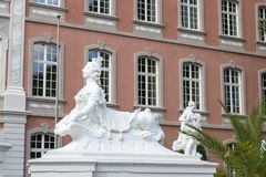 Sculptures in front of the Prince-elector Palace in the center of Trier. Trier, Germany - July 06, 2018: Sculptures in front of the Prince-elector Palace in the stock photos