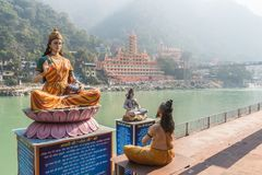 Sculptures of the Ganges, Shiva and the wise man stock photography
