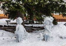 Sculptures of girls on the snow in Belokurikha, Altai, Russia royalty free stock photo