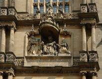 Sculptures on a house facade in Oxford Royalty Free Stock Photography