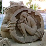 Sculptures made of sand. Festival of fairy-tale sand sculptures at the walls of the Peter and Paul Fortress in St. Petersburg. Russia. Thumbelina stock photo