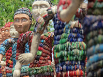 Sculptures made of waste bangles. Sculptures made by Nek Chand out of industrial & home waste and thrown-away items, Rock Garden, Chandigarh, India Royalty Free Stock Photos