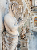 Sculptures in Massandra palace in Crimea. Sculptures in Massandra palace - satyres and chimeras closeup view Stock Photo